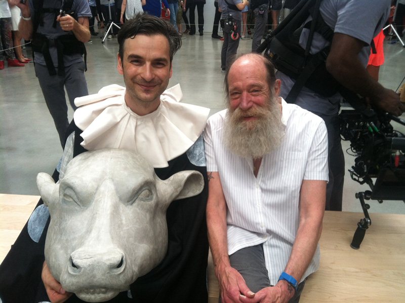 "Marcel Dzama with artist Lawrence Weiner on the set of Jay Z's ""Picasso Baby"" performance at Pace Gallery, New York City. (2013)"